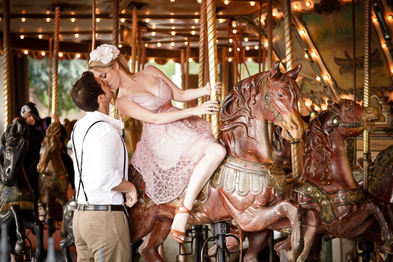 Engagement Photo of Couple on the Carousel at Griffith Park