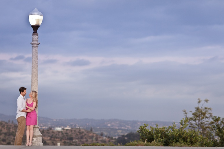 Engagement Photo of Couple by Lamp Post at Griffith Observatory