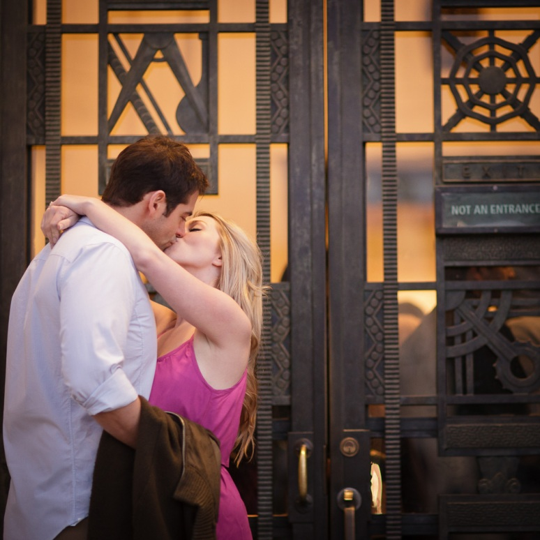 Engagement Photo of Couple by Doors of Griffith Observatory at Night