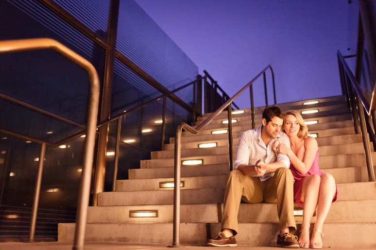 Engaged Couple Sitting on Stairs of Griffith Observatory at Night