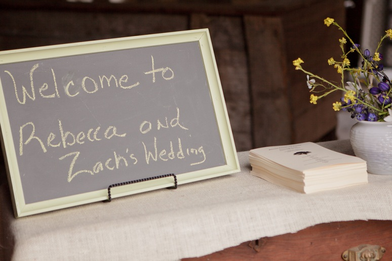 Vintage Wedding Photographer DIY Sign at Entrance of Barn
