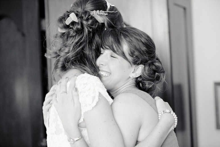 Chileno Valley Ranch Wedding Photographer Bride Hugging Bridesmaid