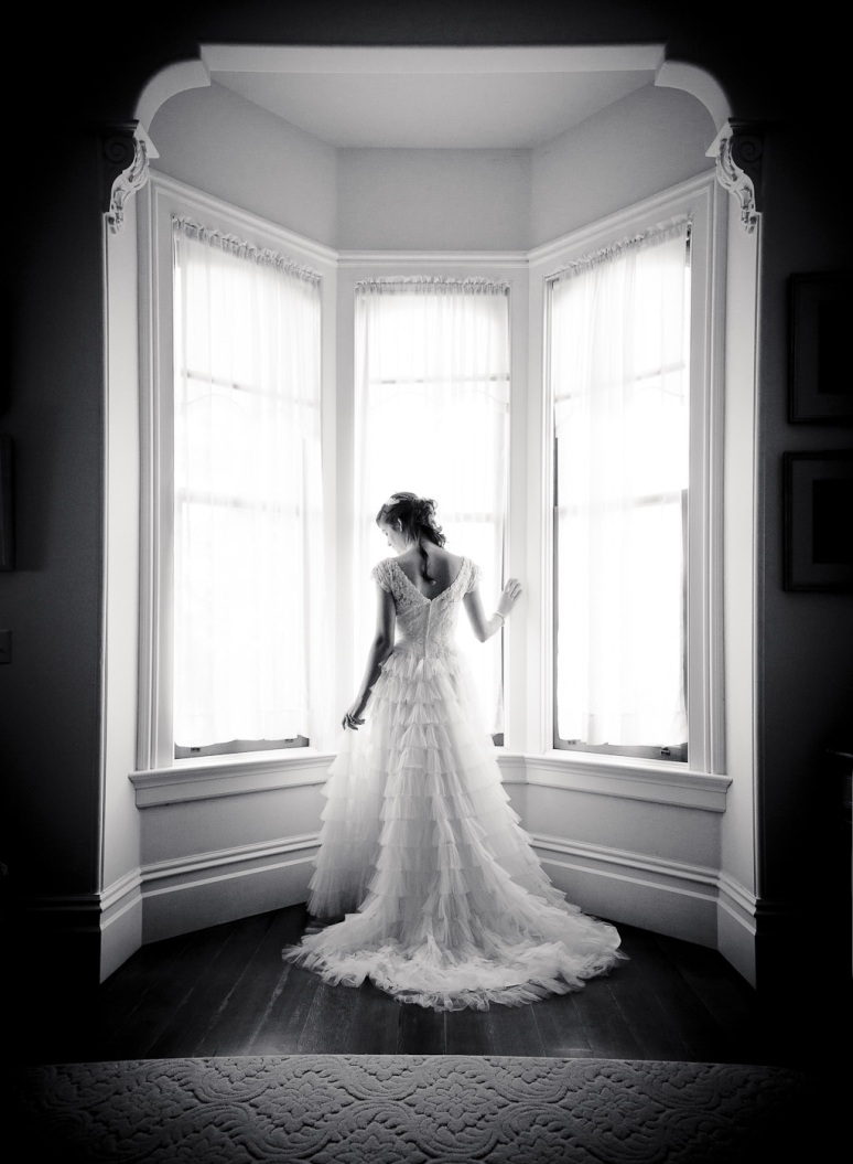Bride in 1950s Vintage Wedding Gown in Window of Chileno Valley Ranch Wedding