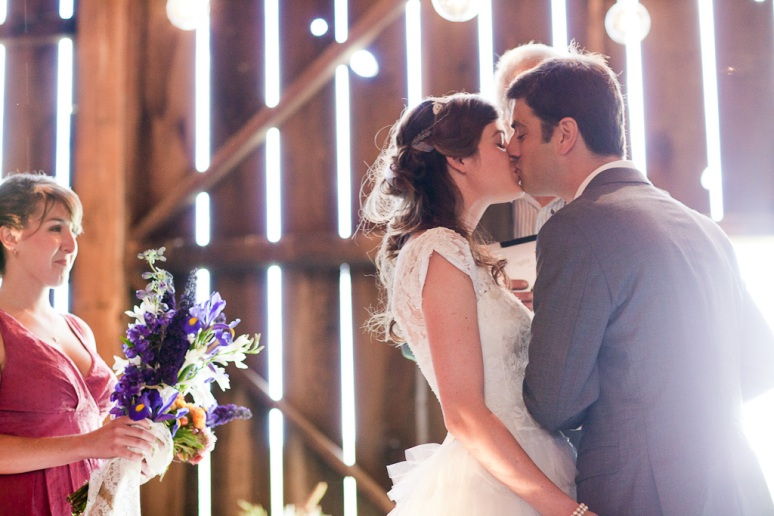 Bride and Groom Kissing at the vintage DIY barn wedding in Sonoma