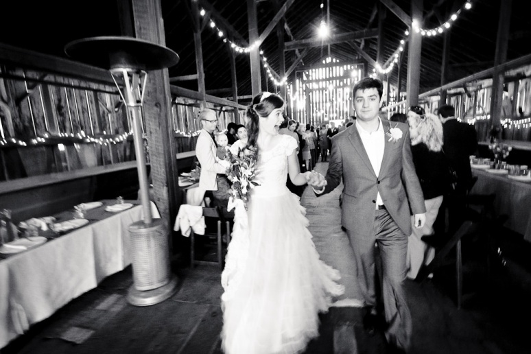 Bride and Groom walking down the aisle at their DIY barn wedding in Sonoma