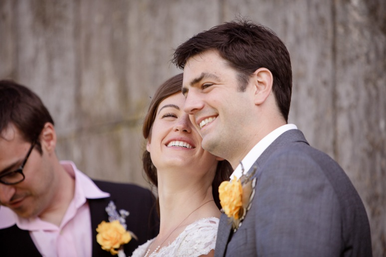 Bride Smiling at Groom outside barn at their wedding at Chileno Valley Ranch