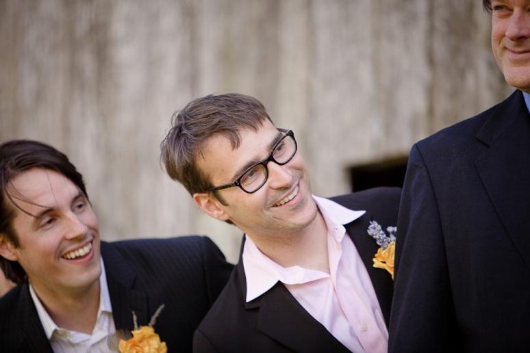Groomsmen watching the couple at their wedding in Petauma