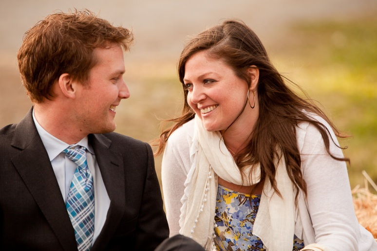 Couple smiling and laughing at each other at a wedding in Chileno Valley Ranch
