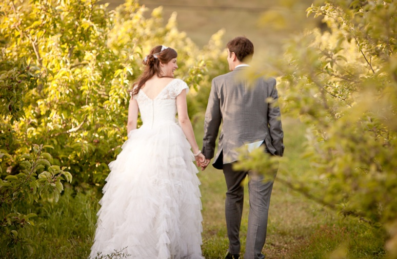 Rustic Vintage Wedding Photographer Shot of Couple walking through a vineyard