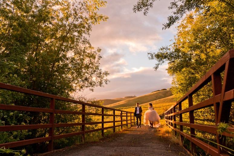 Rustic Vintage Wedding Photographer Bride and Groom Crossing Bridge at Chileno Valley Ranch