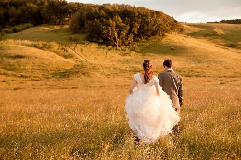 Rustic Vintage Wedding Photographer Bride and Groom Walking Through Field in Petaluma