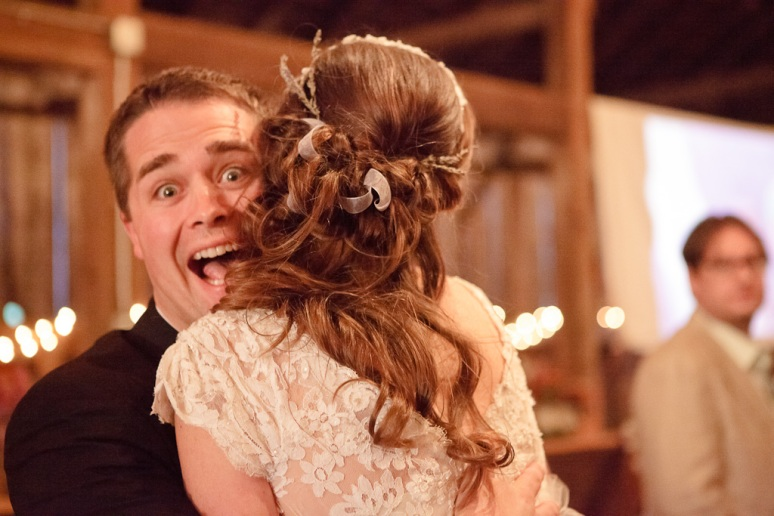 Rustic Vintage Wedding Photographer Bride Hugging Guest and Laughing
