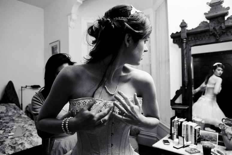 Rustic Vintage Wedding Photographer Bride Changing Into Corset at Chileno Valley Ranch
