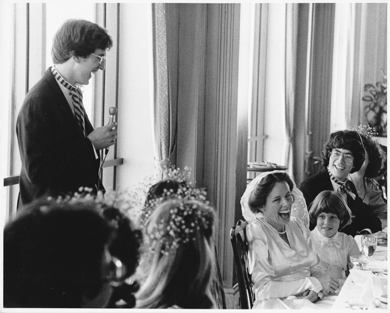1970s Wedding Photograph of Groom Giving Tast and Bride Laughing