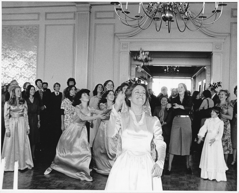 1970s Wedding Photograph of Bride tossing bouquet at the Saint Louis Cathedral