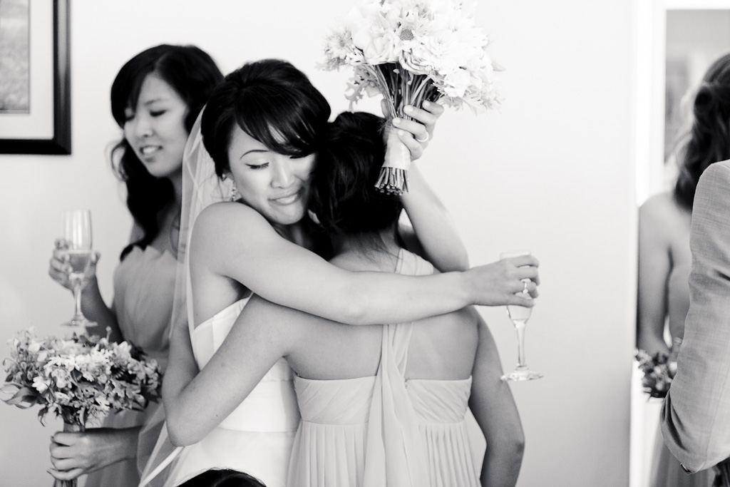 Santa Cruz Wedding Photographer Bride Hugging Maid of Honor
