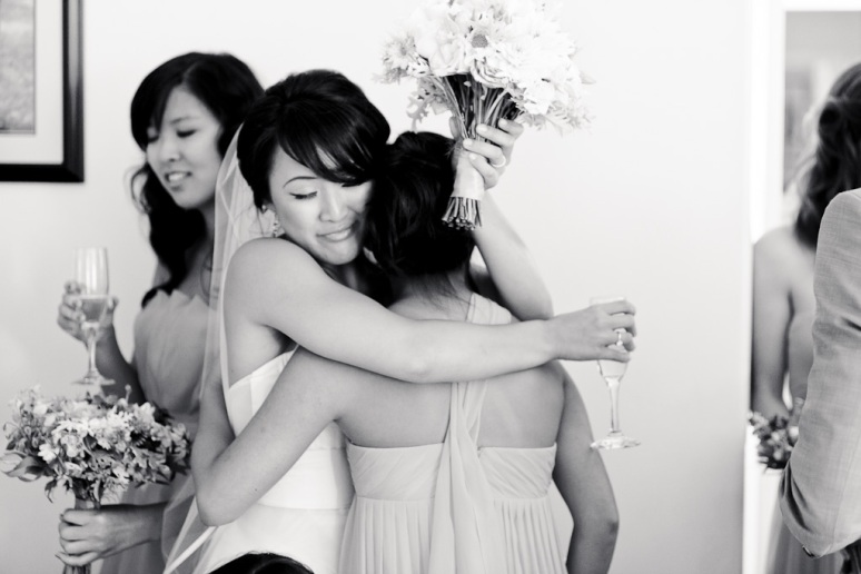 Santa Cruz Wedding Photographer Bride Hugging Maid of Honor