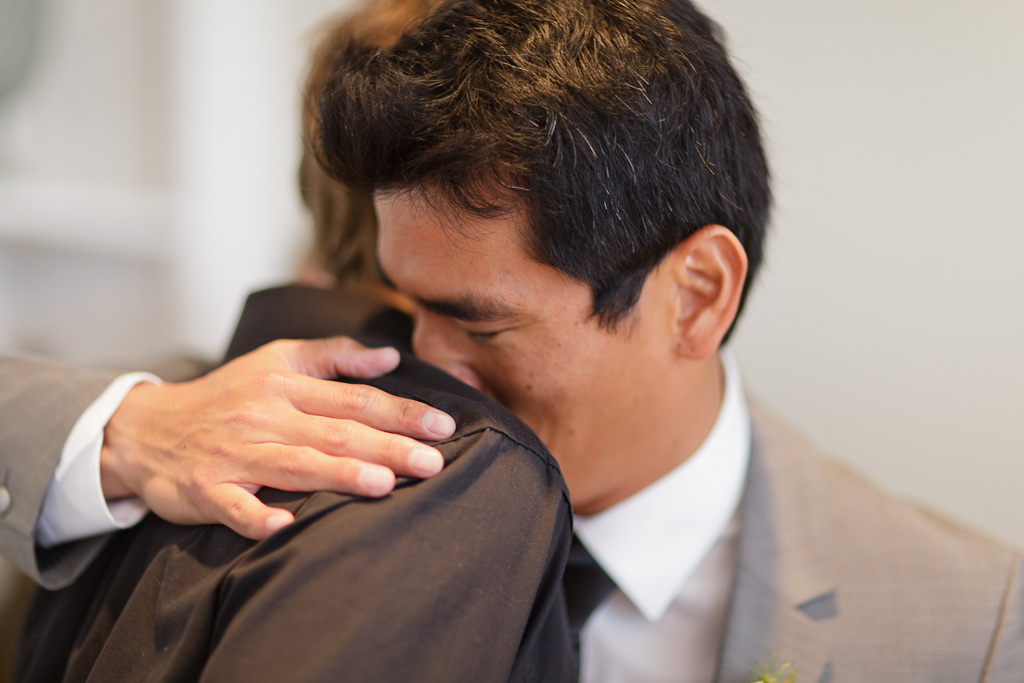 Santa Cruz Wedding Photographer Groom Hugging Best Man