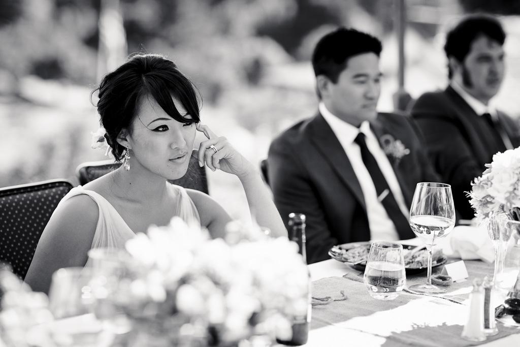 Santa Cruz Wedding Photographer Bride Watching Toasts at Hollins House