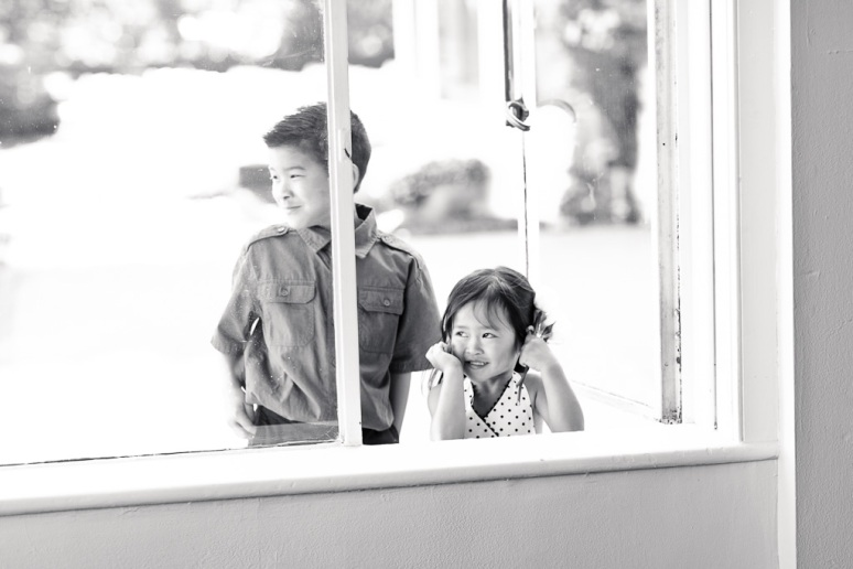 Santa Cruz Wedding Photographer children watching first dance through window