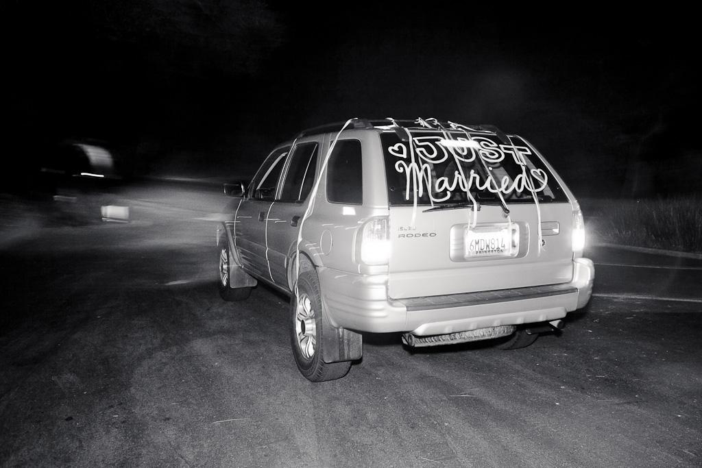 Santa Cruz Wedding Photographer Bride and Groom Leaving Wedding