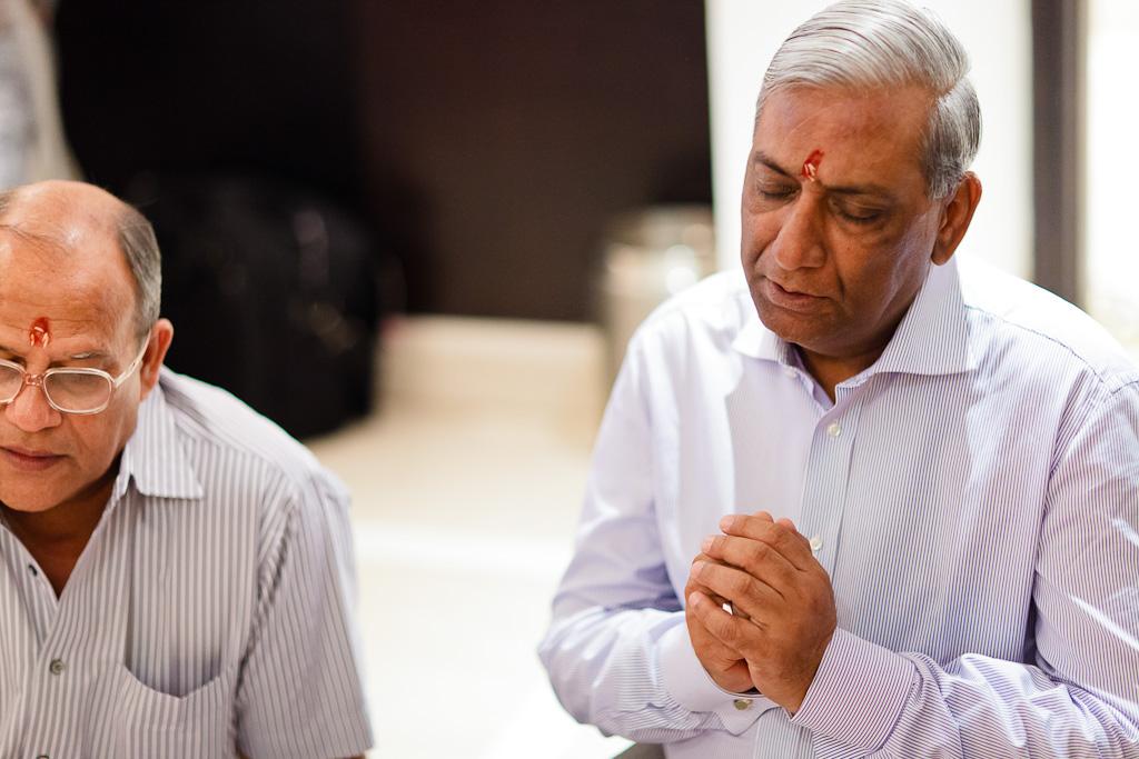 Indian Wedding Photographer Pooja Tumeric Ceremony Father Praying New Delhi