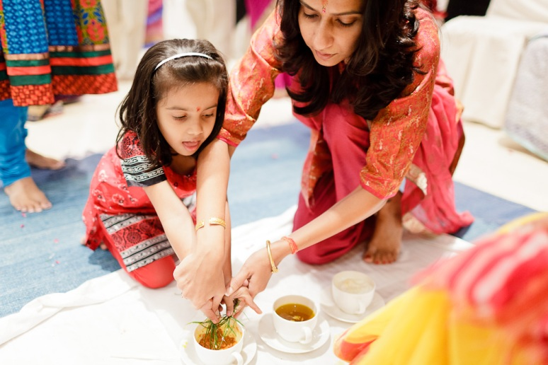 Indian Wedding Photographer Pooja Tumeric Ceremony Niece with Herbs New Delhi
