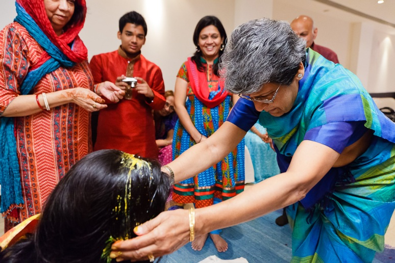 Indian Wedding Photographer Pooja Tumeric Ceremony Mother Blessing Bride New Delhi