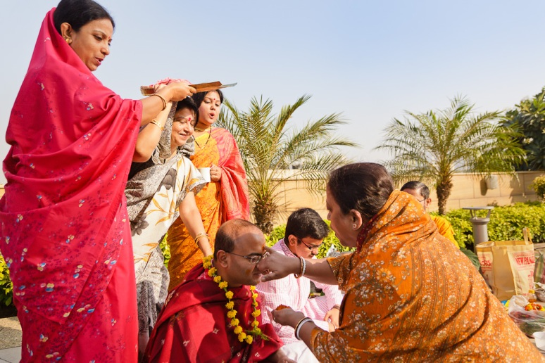 Indian Wedding Photographer Pooja Tumeric Ceremony Aunt's Blessing New Delhi