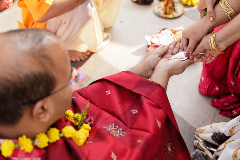 Indian Wedding Photographer Pooja Tumeric Ceremony Grooms Hands New Delhi
