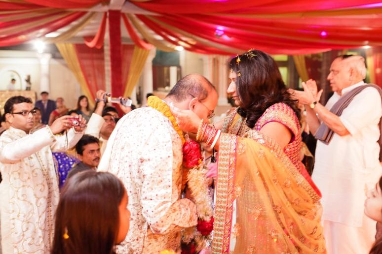 New Delhi Indian Wedding Photographer Grace Havlak Bride Placing Garland on Groom