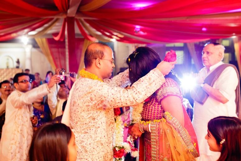 New Delhi Indian Wedding Photographer Grace Havlak Groom Placing Garland on Bride