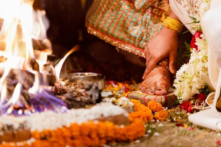 New Delhi Indian Wedding Photographer Grace Havlak Groom Holding Bride's Foot