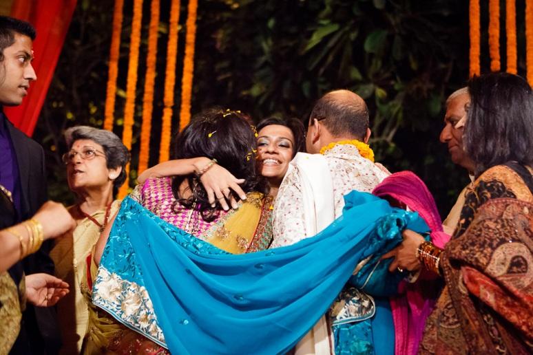 New Delhi Indian Wedding Photographer Grace Havlak Sister Hugging Bride and Groom