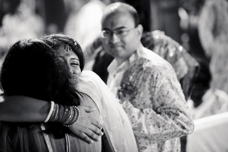 New Delhi Indian Wedding Photographer Grace Havlak Bride Hugging Sister
