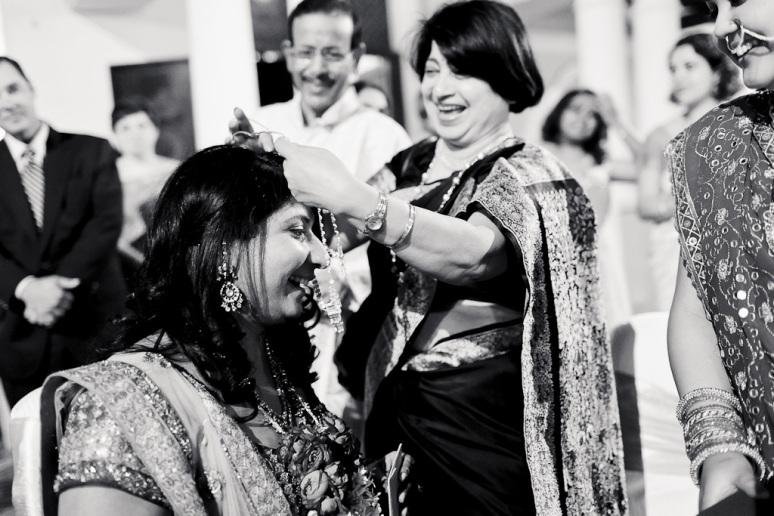New Delhi Indian Wedding Photographer Grace Havlak Grooms Mother Giving Bride Jewelry