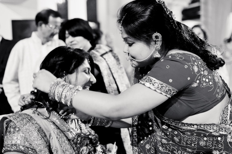 New Delhi Indian Wedding Photographer Grace Havlak Grooms Sister Giving Bride Jewelry