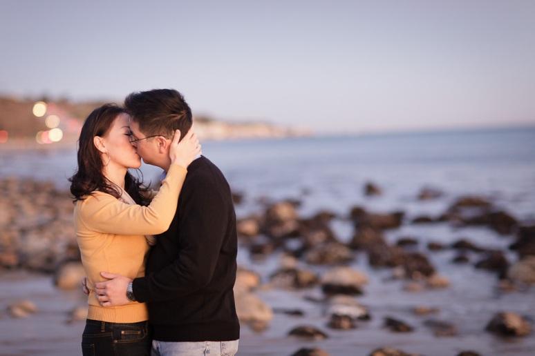 Los Angeles Engagement Session Malibu Wedding Couple Kissing on Beach