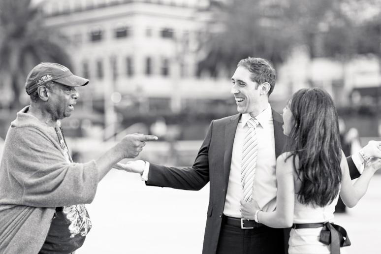 Man singing to couple during San Francisco Engagement Session in Union Square