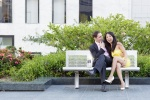 Couple sitting on bench in Union Square during San Francisco Engagement Session