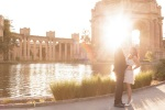 Couple with sun lare during San Francisco Engagement Session at the Palace of Fine Arts in San Francisco