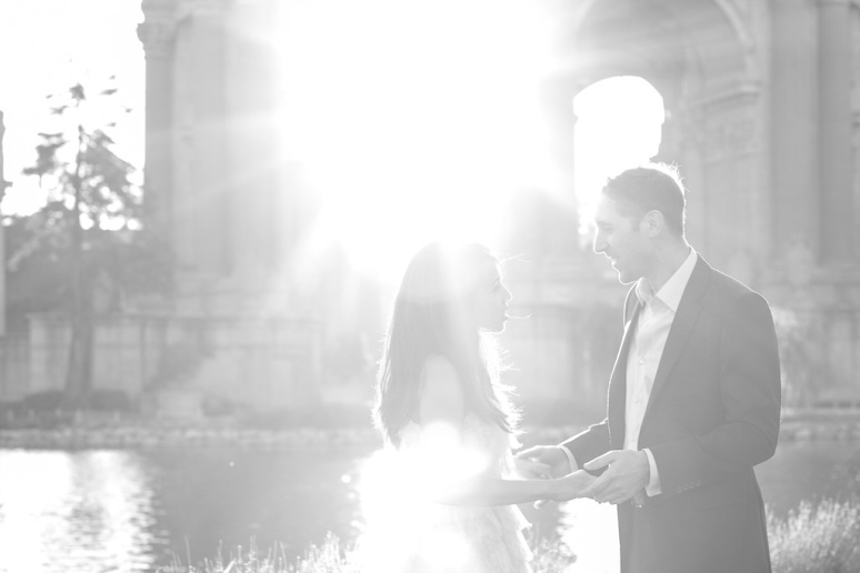 Bride and Groom looking at each other during a San Francisco Engagement Session at the Palace of Fine Arts