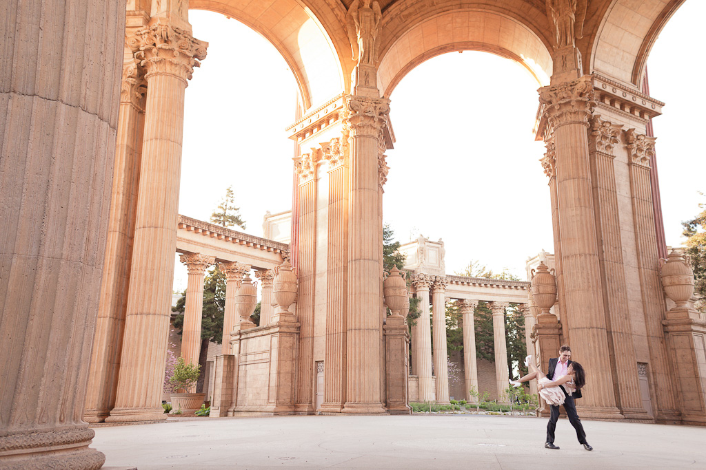 Groom holding bride during their Engagement Session at the Palace of Fine Arts in San Francisco