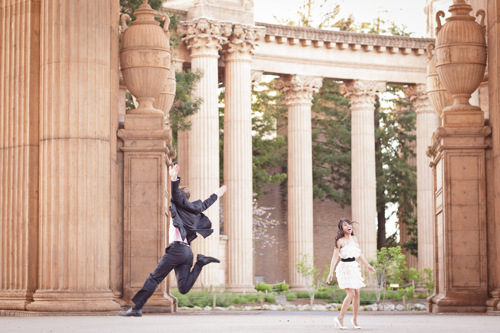 Groom jumping during an Engagement Session at the Palace of Fine Arts in San Francisco