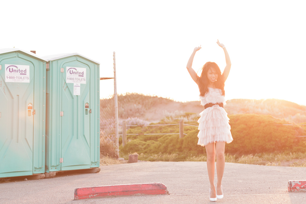 Bride dancing by port-a-potties at Baker Beach in San Francisco