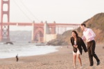 Bride and groom laughing in front of the Golden Gate Bridge at Baker Beach during their San Francisco Engagement Session