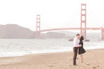 Bride and groom kissing in front of the Golden Gate Bridge at Baker Beach during their San Francisco Engagement Session