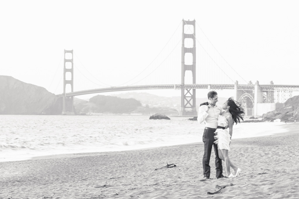 Bride and groom in front of the Golden Gate Bridge at Baker Beach during their San Francisco Engagement Session