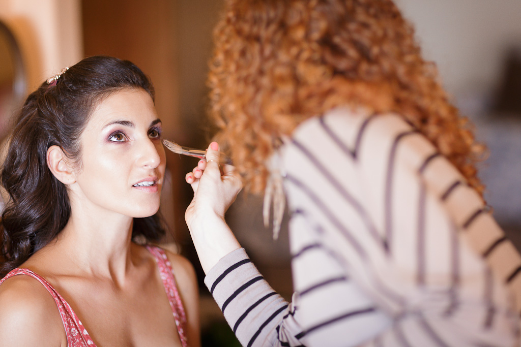 Santa Barbara Candid Wedding Photographer Bride getting her makeup done at Apple Creek Ranch