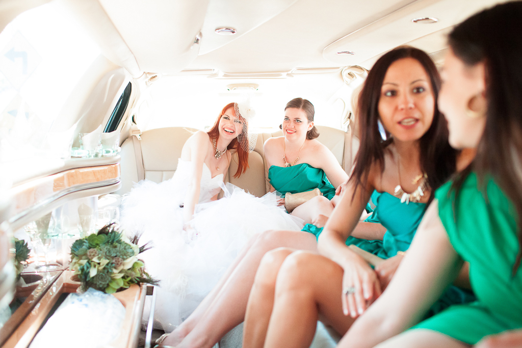 Los Angeles Wedding Photographer bride and bridesmaids in their limo